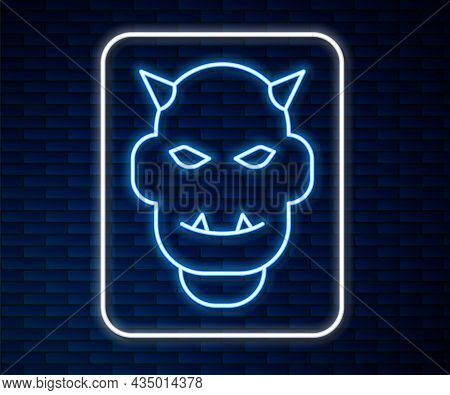 Glowing Neon Line Mask Of The Devil With Horns Icon Isolated On Brick Wall Background. Vector