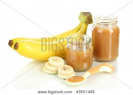 Baby puree with bananas isolated on white