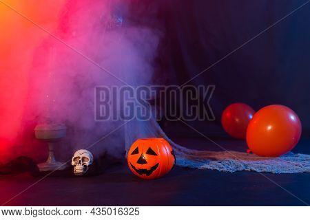 Symbol Of Halloween. Jack-o-lantern On A Dark Background. Halloween Card. Lamp In Decorations. Backg