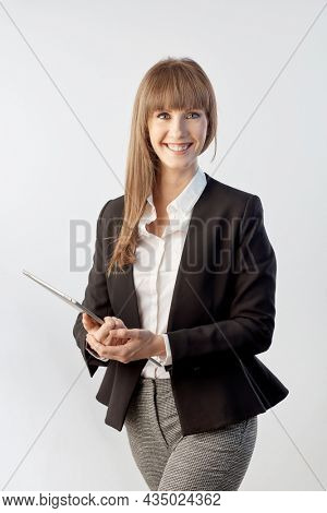 Happy white young businesswoman holding large business tablet Woman with happy smile, isolated on white.