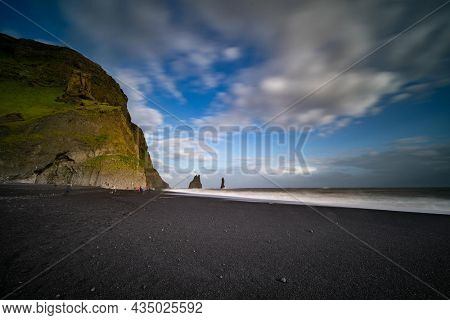 The cliffs by the township of Vik in Iceland Reynisdrangar basalt sea stacks
