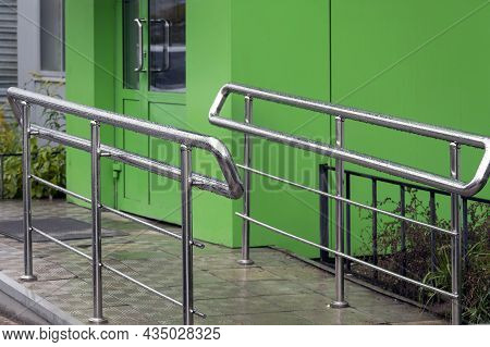 Wat Stainless Steel Rat Fence Near A Modern Building.  A Dangerous Situation. Shiny Steel Railings A
