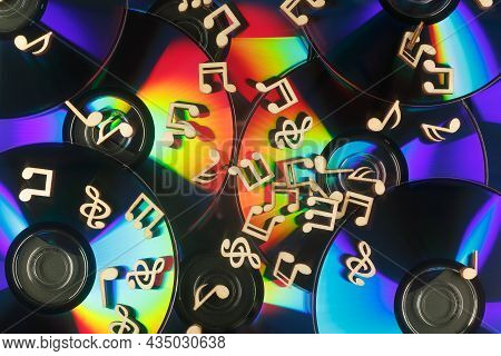 Musical Notes Lie On The Surface Of Cds With A Refractive Effect.