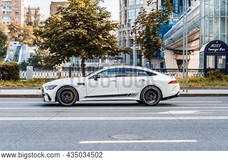 Mercedes-amg Gt 63 S 4-door Coupe Car On The Street. Side View Of White Mercedes Amg Gt 63 S Drive I