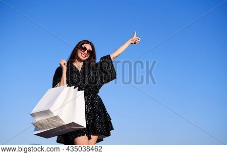 Luxury Dreamy Caucasian Fashionable Woman Showing Thumbs Up Gesture. Girl With Credit Card And White