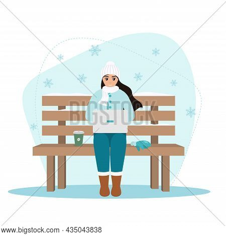 Young Woman Freelancer With Laptop And Coffee Sitting On The Bench In Winter Nature With Snowflakes.