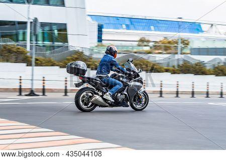 Rider On The Honda Vfr1200f Motorbike Riding On Street. Motorcycle Running On The Asphalt Road In Ci