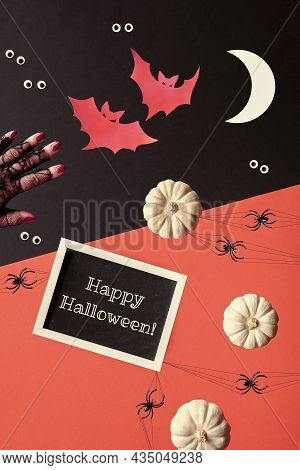 Abstract Halloween Composition In Red, Black And White. Text Happy Halloween On Blackboard. Paper Si