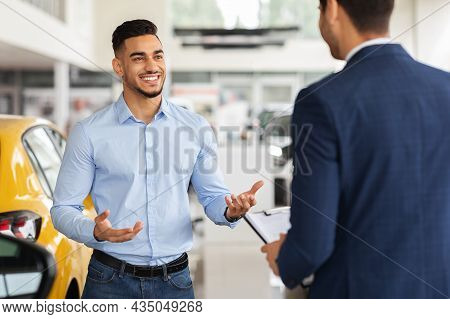 Rich Middle-eastern Man Visiting Newest Showroom, Talking To Manager