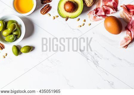 Keto Diet Ingredients Frame On White Marble Background, Copy Space. Ketogenic Food Concept.