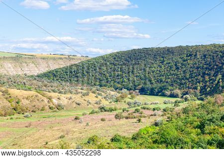 Green Landscape With Hills And Forest . Spectacular Nature In The Summer . Rolling Hills Scenery