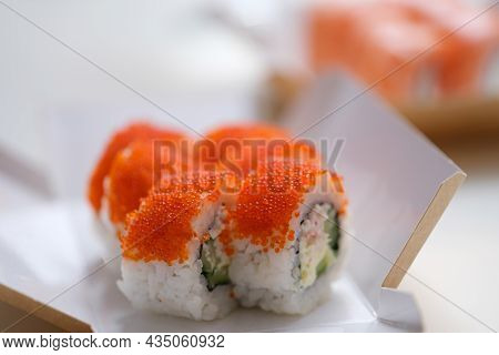 Closeup Of Portion Of Sushi With Flying Fish Roe