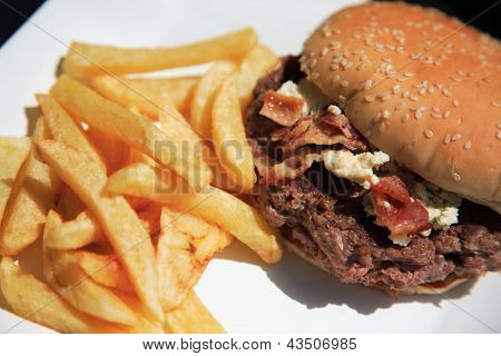 Looking Down On A Juicy Beef Burger And Fries