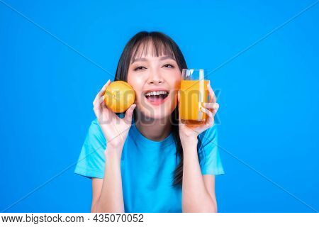 Beautiful Beauty Asian Woman Cute Girl With Bangs Hair Style In Blue T Shirt Feel Happy Drinking Ora