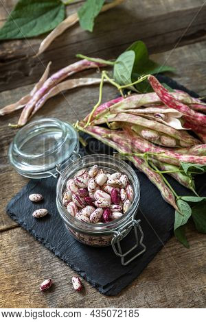 Beans Of Bean, Brown Bean (of Dried Beans) In A Glass Jar On A Rustic Table. Food Background.