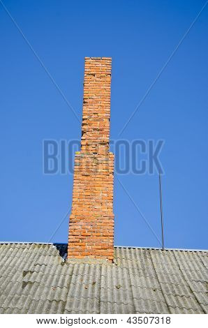 Old Chimney On Roof And Sky Background