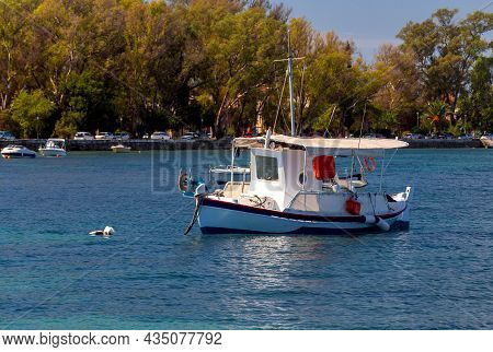 Kerkyra. Greece. View Of The Coastline And Fishing Boats On A Sunny Day.