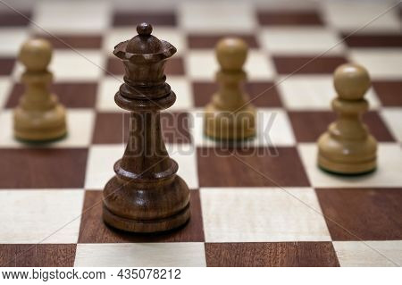 Wooden Chess Board With Chess Pieces. Checkmate