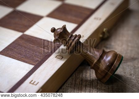 Chess Piece And Wooden Chess Board On The Table. Board Game