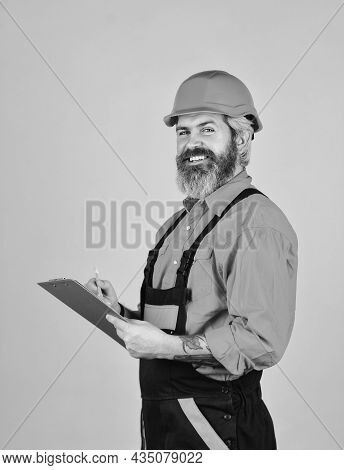 Checklist. Inspecting. Control Concept. Foreman With Document. Delivering Building Materials. Man In