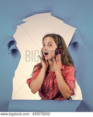 I Love This Song. Child Listening Music In Earphones. Modern Technology In School Education. Learnin