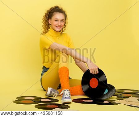 Pretty Teen Girl Holding Vinyl Record In Her Hands. Portrait Of Happy Girl Wearing Retro Style Brigh