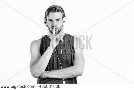 Man Handsome Unshaven Hipster Listening Music Using Headphones Gadget. Listen Music For Motivation A