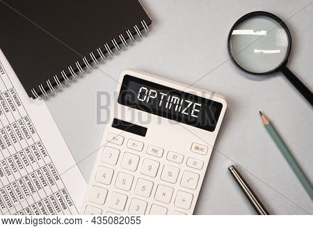 Optimize Word On Calculator. Tax And Financial Optimization Concept.