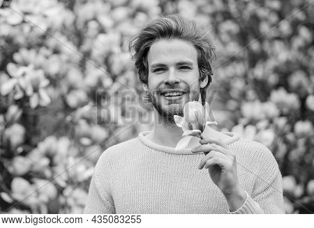 Male Beauty. Hair Care And Beauty. Unshaven Man Magnolia Bloom. Beautiful Hairstyle. Hipster Enjoy B