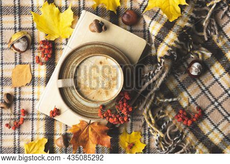 Atmospheric Cozy Autumn Composition. Hot Mug Of Coffee, Book, Fall Leaves, Chestnut, Ashberry, Acorn