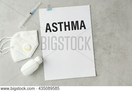 Paper With Text Asthma On A Table With Stethoscope. Medicina