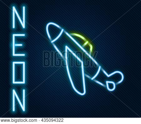 Glowing Neon Line Toy Plane Icon Isolated On Black Background. Flying Airplane Icon. Airliner Sign.