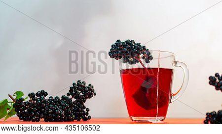Healing Tea From Black Elderberries, Homeopathy, Red Hibiscus Tea Copy Space.