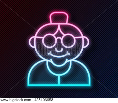Glowing Neon Line Grandmother Icon Isolated On Black Background. Vector