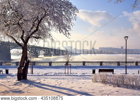 Michael's Embankment In Winter. Oktyabrsky Bridge Over The Ob River Leads To The Gorsky District