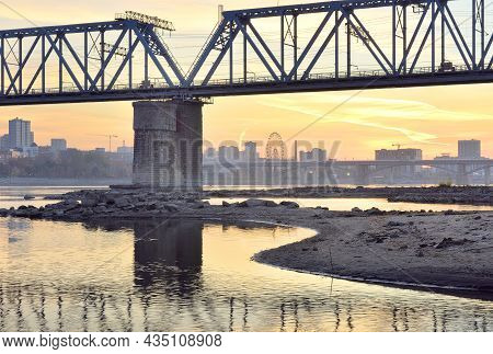Railway Bridge On The Ob River. Embankment Of The Capital Of Siberia At Dawn