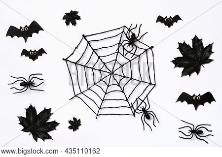 Halloween Pattern With Black Maple Leaves, Spiders And Bats. Spooky Flat Lay On White Background For