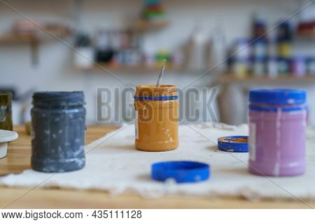 Artisan Workplace: Open Jars With Paint For Decorating Pottery And Ceramics On Table In Workshop. St