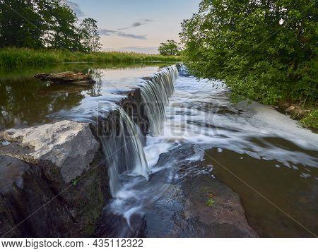 Cool Summer Evening At A Small Waterfall In Finnish Vantaa.