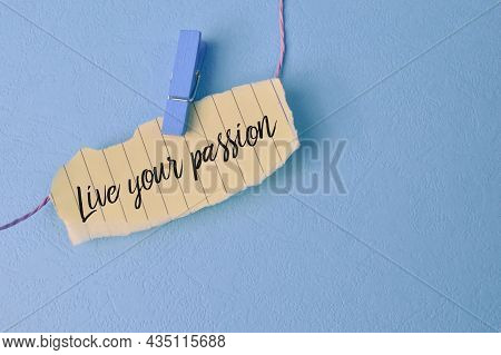 Torn Paper Written With Text Live Your Passion Isolated On A Blue Background