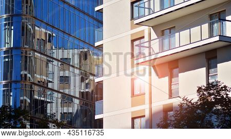 Corporate Architecture Building. New Modern Office Building. Textured Blue Pane Of Contemporary Glas