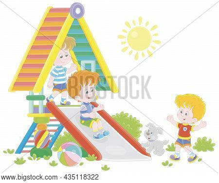 Happy Little Kids Playing On A Colorful Toy Slide On A Playground In A Green Summer Park On A Sunny