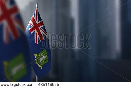 Small Flags Of British Virgin Islands On A Blurry Background Of The City
