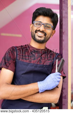 Happy Smiling Barber At Saloon Confidently Looking At Camera In Front Of Door - Concept Of Happiness