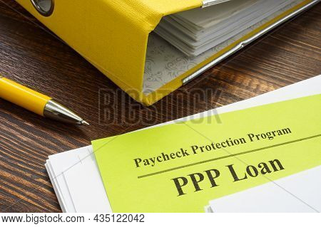 Paycheck Protection Program Or Ppp Loan Papers And Yellow Folder.