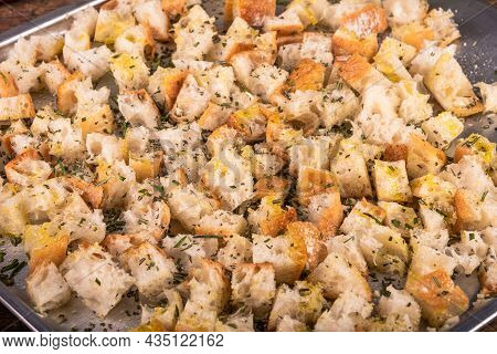 Ciabatta Cubes Prepared For Baking With Olive Oil And Rosemary On A Baking Sheet, Close-up, Making C