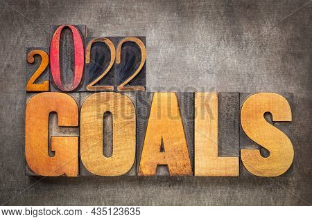 2022 goals - New Year resolutions and goal setting concept - word abstract in vintage letterpress wood type blocks against grunge metal background
