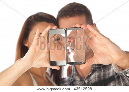 Happy Couple Makes Self Photo Giving A Kiss