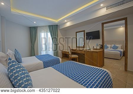 Twin Beds In Family Room Suite At A Luxury Hotel With Adjoining Bedroom