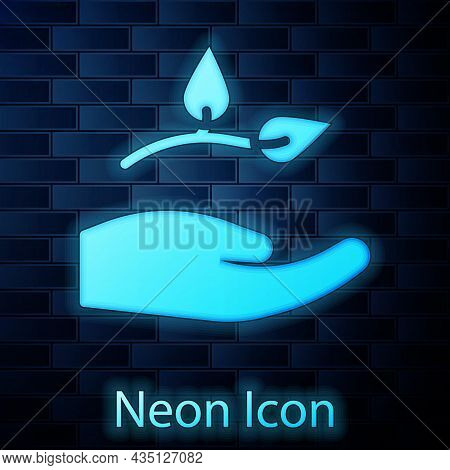 Glowing Neon Leaf In Hand Of Environmental Protection Icon Isolated On Brick Wall Background. Seed A